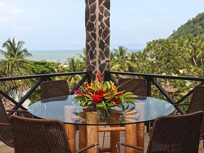 Ocean view terrace with dining table