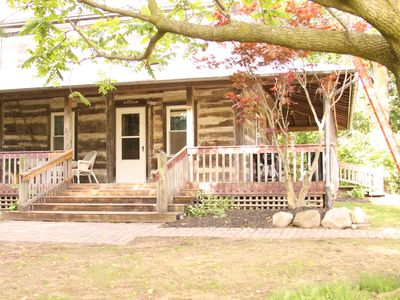 Photo for Beautiful and Historic Log Cabin for family or couple getaway - huge hot tub!!