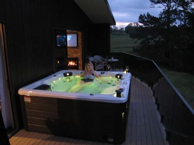 Spa in the evenings with phone dock, raised speakers, lights and waterfall