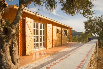 Sougia wooden Eco-house among olive trees and mountains, distant sea view