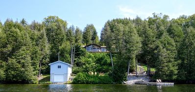 A view of the cottage and dock from out on the lake.