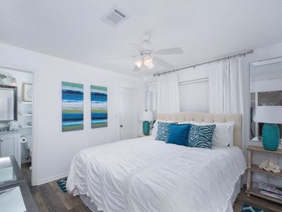 Master suite offers comfortable king bed and en-suite bath