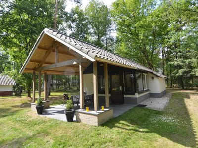 Photo for Detached bungalow with lovely covered terrace in a nature rich holiday park