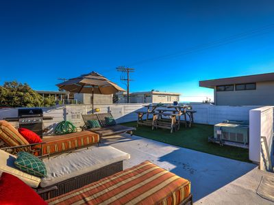 Photo for The Trendy Beachside Getaway - Ocean View Roof Deck, 5 Beds, and Parking!
