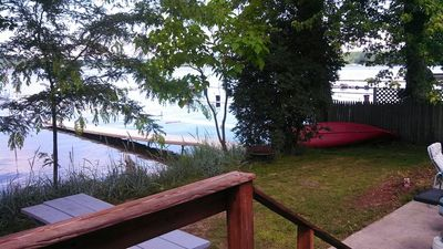 Back yard with private dock and patio. Has fire ring and grill.