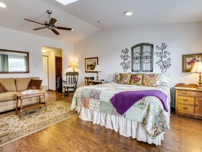 Photo for Cozy garden-themed suite with oceanfront views - bring your dogs along too!