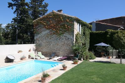 Traditional stone cottage and sun-drenched swimming pool in heart of France.