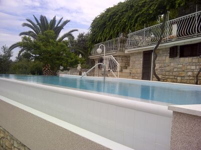 Photo for Large property with the villa and pool in the quiet cove nearby the Town Hvar,HR