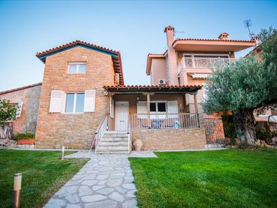 Photo for Fantastically located property with 3 houses directly on the sea, Wifi | Nikiti, Chalcid