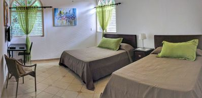 Photo for Comfortable and spacious room, 2 queen beds/private bath for up to 4 guests