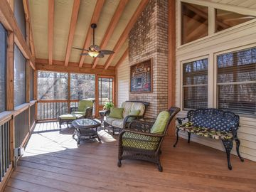 Relax on the quiet expansive porch overlooking the stream, Black