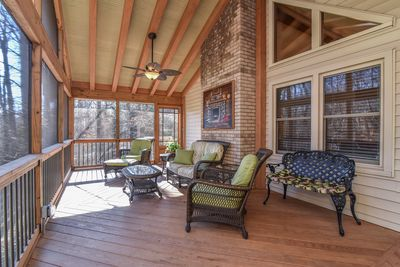Walk into this relaxing, large screened in front porch