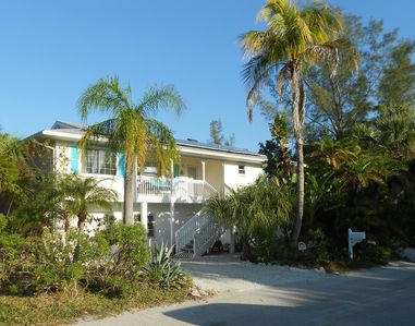Photo for NO REGRETS! Bright elevated luxury SOLAR home.  Quick walk to beach and bay