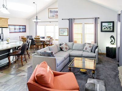 "Living Room - The living space is tastefully furnished and includes a gas fireplace and 52"" flat-screen TV."