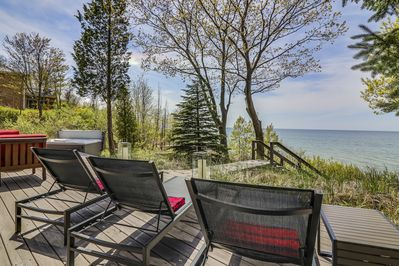 wrap around deck with stunning lake views and amazing sunsets #seagrasscottage