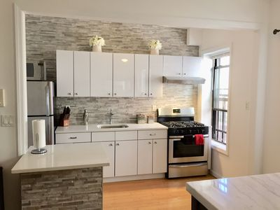 Photo for Renovated Brownstone Apt with High Ceilings