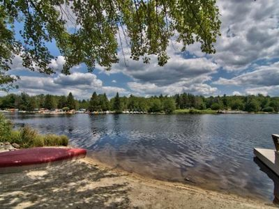 Family friendly Lake Front with huge private beach & dock.