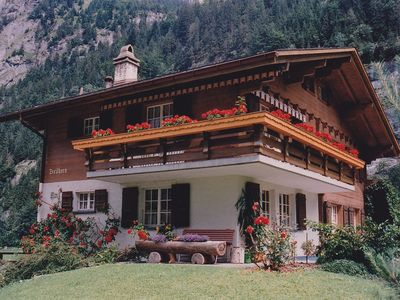 Photo for Holiday-Apartment in Swiss  chalet, in the valley of waterfalls.