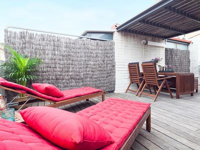 Photo for Apartment Barcelona Rentals - 3 private terrace attic apartments for up to 18pax