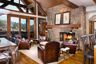 With vaulted ceilings, large windows and wood paneling, this condo is a gorgeous space to stay.