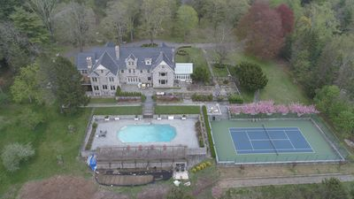 Back high aerial view showcasing our tennis court, pool, gardens and front porch