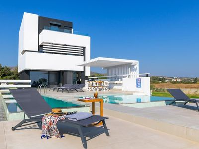 Photo for A modern villa for eight with a gorgeous Aegean Sea view. Villa Pindar is located on the beach close