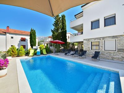 Photo for This 9-bedroom villa for up to 16 guests is located in Starigrad Paklenica and has a private swimmin