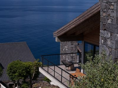 Photo for Casa da Terralta - Beautiful stone house with dream views to the entire bay of Santo Amaro and the P