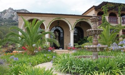 Photo for Exquisite Spanish Colonial Villa-Cozy up by the fireplace after a hike