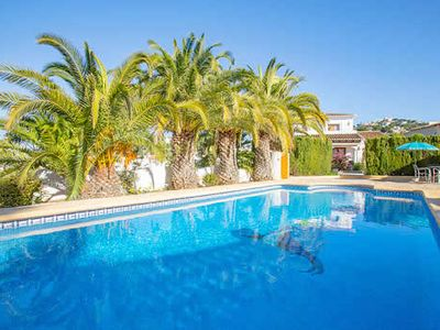Photo for 4 bed 3 bath Spanish-style property w/ pool walking distance to local supermarket, very short drive to centre of resort