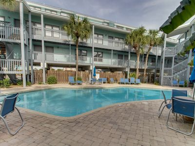 Photo for Stunning water-view condo w/ shared pool; steps away from the beach