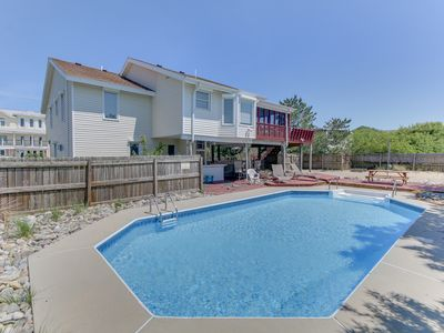 Photo for Just steps to the beach with a pool, 5 bedrooms, 3 baths, sleeps 14