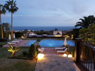 Photo for 9 bedroom villa with guest houses, tennis court, pool and stunning sea views