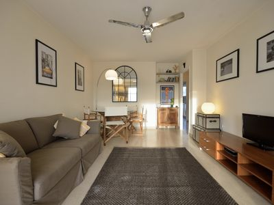 Photo for Stylish flat in small gated residence with beautiful pool and lush gardens