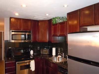 Beautifully updated full kitchen - all stainless, granite counter tops