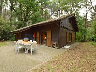 Photo for Attractive, detached wooden chalet with private garden, in the middle of a natural area