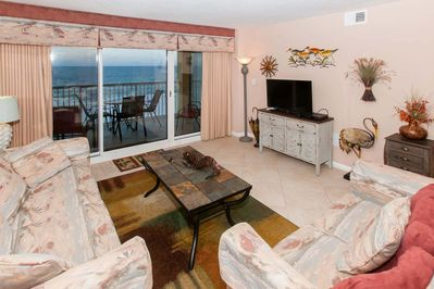 Living room with 31-inch flat screen TV and sliding glass doors to Gulf-front balcony