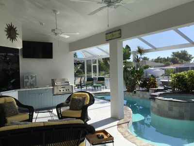Photo for Free Beach Parking!  Beautiful Canal Home with Pool/Waterfall!