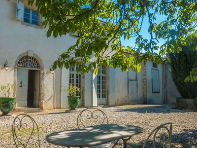 Photo for Spacious cottage on wine estate with private swimming pool in wooded southern France