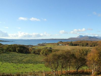 View from the sitting room to Dun Scaith Castle, the loch and the Cuillins.