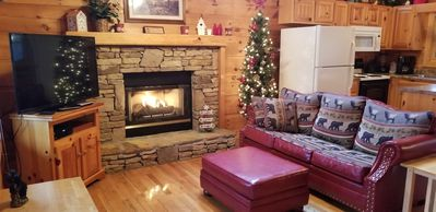 Living area by the fireplace on the main level as you enter Eagle's Crown