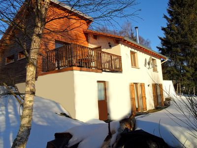Photo for South-facing chalet with views of forest and mountains in peaceful setting