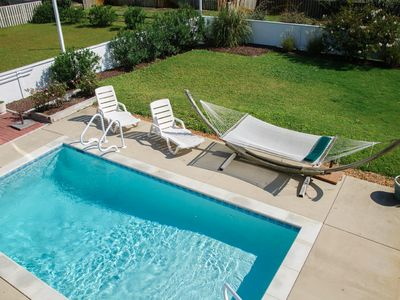 Photo for Heels In The Sand: Close to the beach, elevator, 4 bedrooms, and a heated pool.