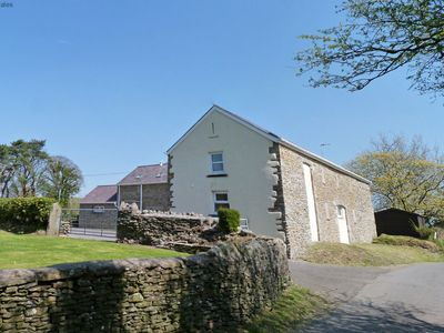 Photo for Stylish, sleek and modern, this Pontardawe holiday cottage is located on a tranquil farm in the stun