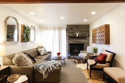 """Beautiful Living Room w/ Gas Fireplace, Wall Mounted 49"""" Smart TV and Patio Door"""