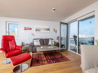 Photo for Modern and cozy - right on the harbor promenade of the OstseeResort Olpeni