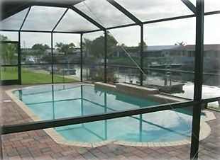 Heated Screened in Pool-out your back door and steps from the water