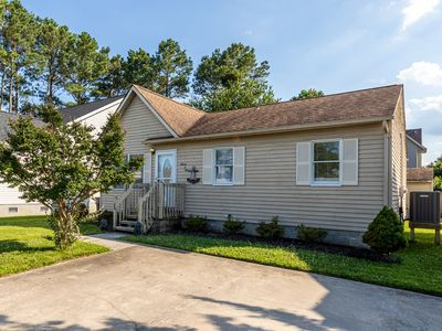 Photo for Updated home in a quiet neighborhood w/ yard & grill - walk to beach/dining!