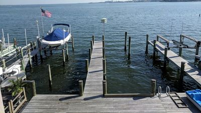 Bay front townhouse with boat slip and dock in  great midtown location!
