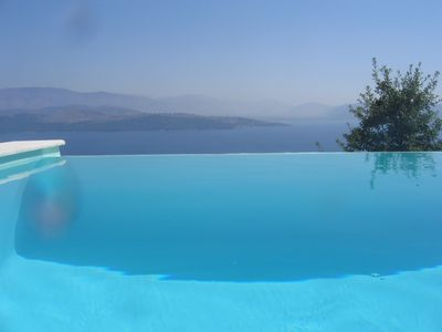 Photo for Contemporary villa in prime location with stunning views and heated infinity